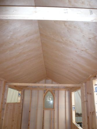 A beautiful ceiling! Taken from the kitchen area, looking towards the church window that will be above the bed. The rafter ties are temporary.